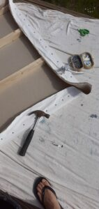 The art process starts with the creation of the canvas.  Hammer, tacks, linen and wood